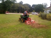 Tilling the first garden.
